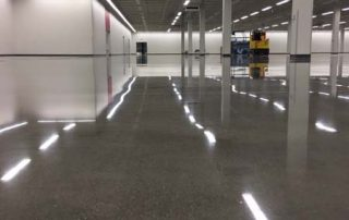 polish floor in warehouse with columns